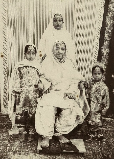 1890. A Sikh grandmother, her daughter, and granddaughters. Source: Bonham's auction lot 306.