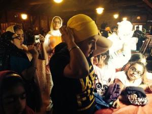 Harleen giving a dastar tying demo at Camp Sikh Virsa