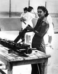 A Sikh woman working on a gun during WWII. 1940s. Source: Sikhs Past & Present.