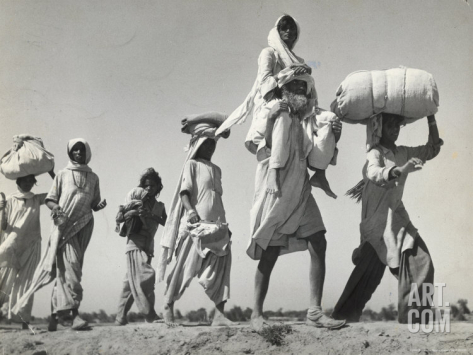 A Sikh carrying his wife as they migrate during the 1947 Partition of Punjab. Photo by Margaret Bourke White. This image comes from the historical archives of LIFE Magazine. Source: Art.com