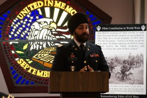 Major Kamaljit Singh Kalsi welcomes community and Pentagon officials to the event. Photo by Sharat Raju.