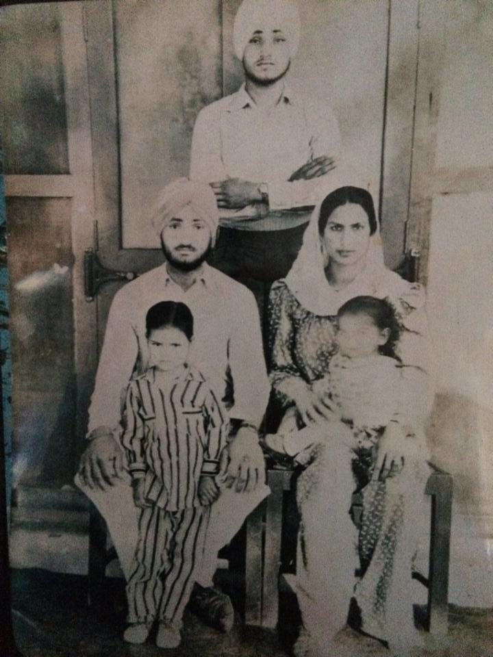1947. Punjab. Sikh husband & wife, with their children. Husband's younger brother stands in the back. Private collection.