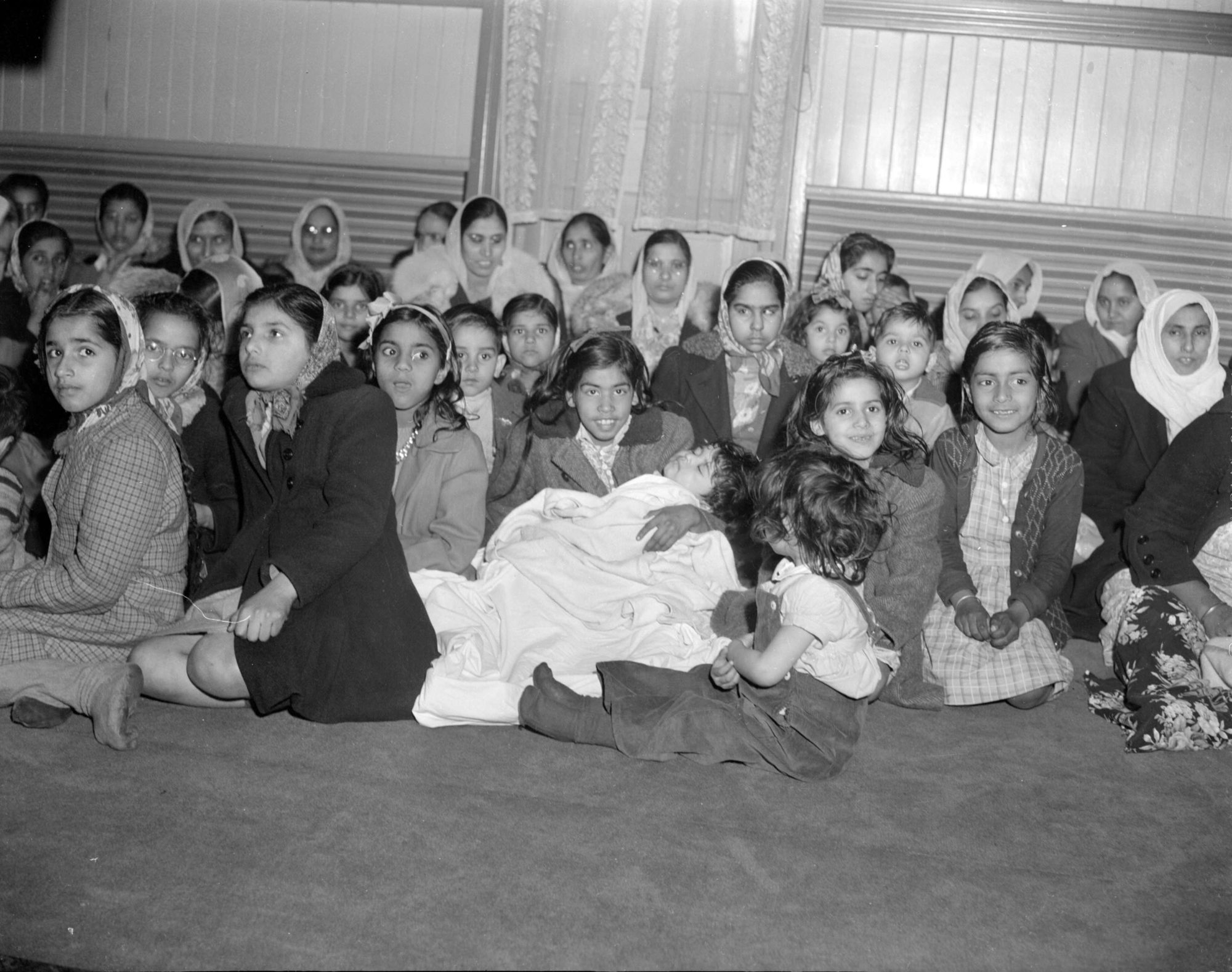 March 1945. Women & children inside the Khalsa Diwan Society of Vancouver. Photo by Don Coltman. Source: City of Vancouver Archives.