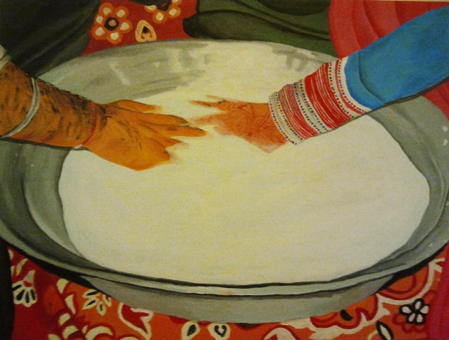 """""""Kangna,"""" is a traditional Punjabi wedding game. In the time of arranged marriages when the bride and groom didn't know each other the family would set up small games to serve as ice breakers after the wedding. Here is a bowl of raw lassi in which there is a ring which they have to find. It's a game with so many emotions. It could be the first time the bride and groom touch. I like the idea of hands meeting."""