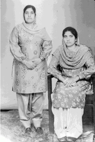 Sikh women; one in her teens and one in her middle age. Source: City of Birmingham Digital Library Archives.
