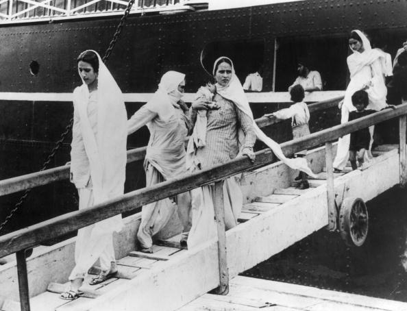 9th October 1947: Hindu and Sikh women and children arriving at Bombay on the British-India liner dOwarkaf after their flight from Pakistan. Photo by Keystone/Getty Images.