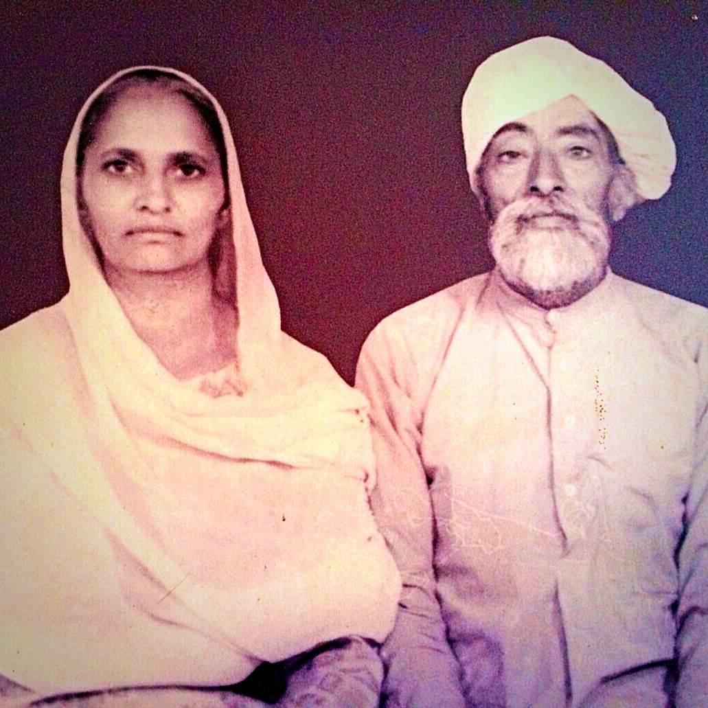 1969. Ratan Kaur Dhariwal sits with her father Guljar Singh Gill. Punjab