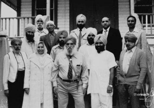 1970. A group of Sikhs in front of a Gurdwara. At the center front is Nand Singh Banga. At his right is Harnam Kaur Thandi and at his left is Gurdev Mastana. A the front right is Nand's younger brother, Hardit Singh Banga. Source: Thereach.ca