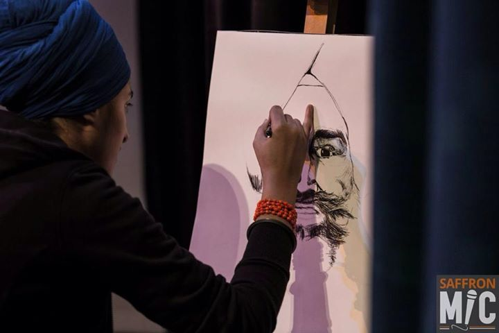 """""""I challenge the Darkness. If nothing else, then at least around myself, I will not let it settle. Around myself I will establish Light.'"""" Shanu Jodhie Kau sketching a live piece of Jaswant Singh Khalra for the Ensaaf at Saffron Mic."""