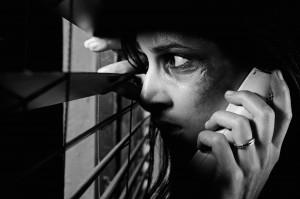 Woman-Peeking-Through-Blinds