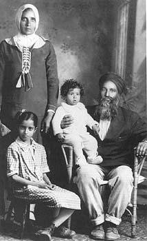 1931, Kelowna B.C. Naranjan Kaur with her children and father Mehar Singh.