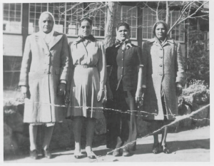 L to R: Naranjan Kaur Singh, Ajit Kaur Singh, Amar Kaur Sangra, and Labh Kaur Sangra. Outside the Aquatic Club in Kelowna, BC. 1946.