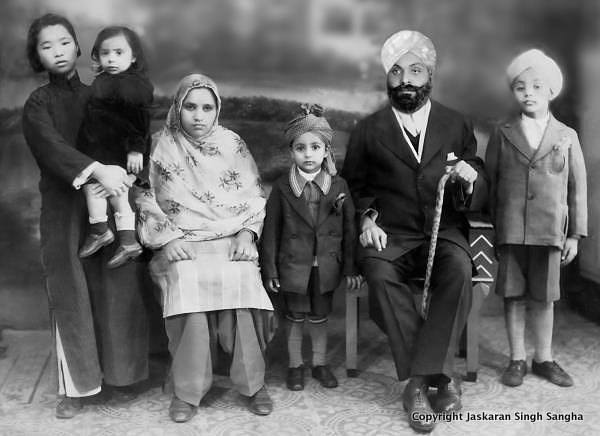 Kartar Singh Sangha, his wife, Nachattar Kaur, and his family with Chinese amah. The little boy in the middle Ranjit Singh Sahgha. All the children were born in Shangha. 1936.Source: https://www.facebook.com/SikhsInShanghai/
